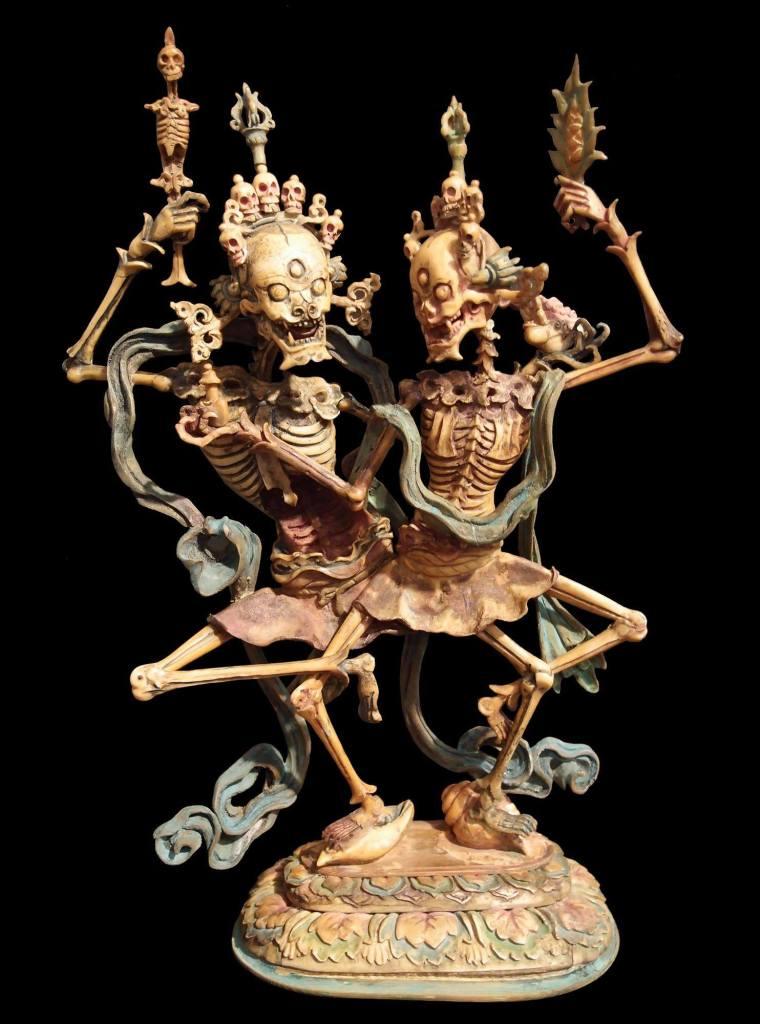 Citipati- graveyard deities that represent perfect awareness and death, dancing.